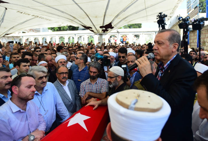 ISTANBUL, TURKEY - JULY 17: Turkish President Recep Tayyip Erdogan adresses the crowd after the funeral service for victims of the thwarted coup in Istanbul at Fatih mosque on July 17, 2016 in Istanbul, Turkey. Clean up operations are continuing in the aftermath of Friday's failed military coup attempt which claimed the lives of more than 250 people. In raids across Turkey 6,000 people have been arrested in relation to the failed coup including high-ranking soldiers and judges, Turkey's Justice Minister Bekir Bozdag has said. (Photo by Burak Kara/Getty Images)