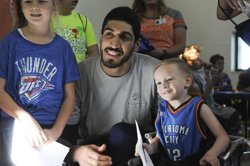 OKC Thunder's Enes Kanter takes a picture with Henry Hale during his visit at the J.D. MacCarty Center Thursday, March 23, 2017