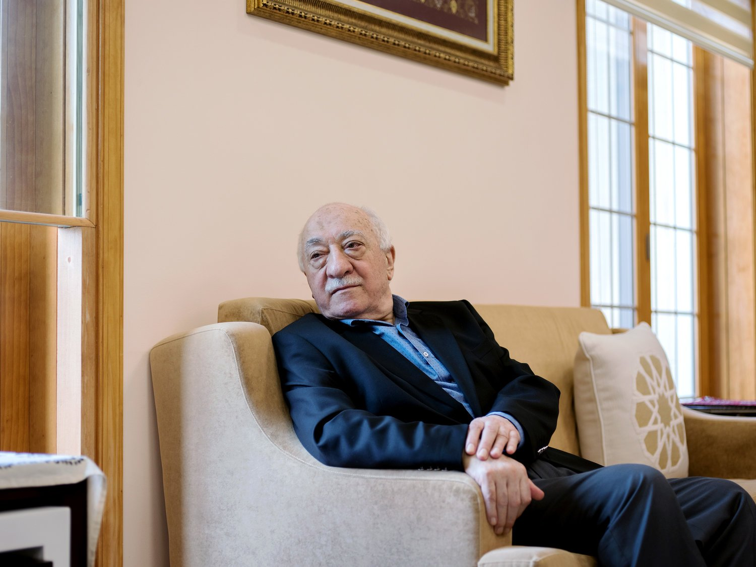 Fethullah Gulen sits in a room at his compound in Saylorsburg, Pennsylvania. He has lived in exile in the United States since the late 1990s. Turkish President Recep Tayyip Erdogan blames Gulen for last year's failed coup and is seeking his extradition. Bryan Thomas for NPR