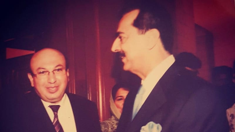 Kacmaz, pictured with a former Pakistan prime minister, had applied for asylum, according to a colleague.