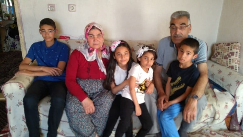 Ümmü and Ali Tüter with their four grandchildren